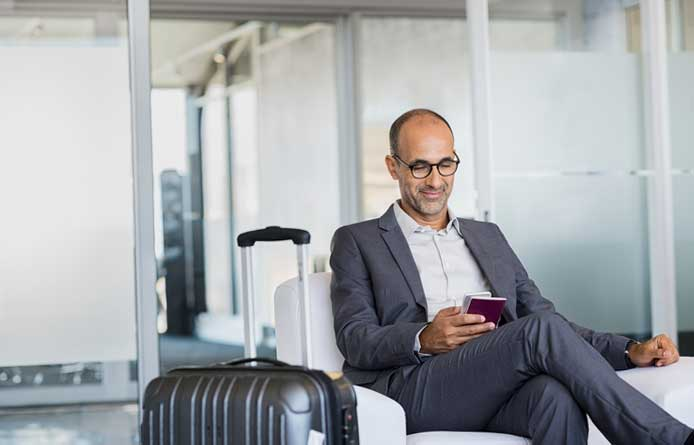 Businessman sat in airport lounge