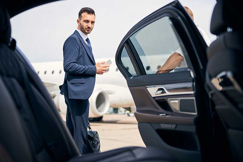 Passenger entering vehicle